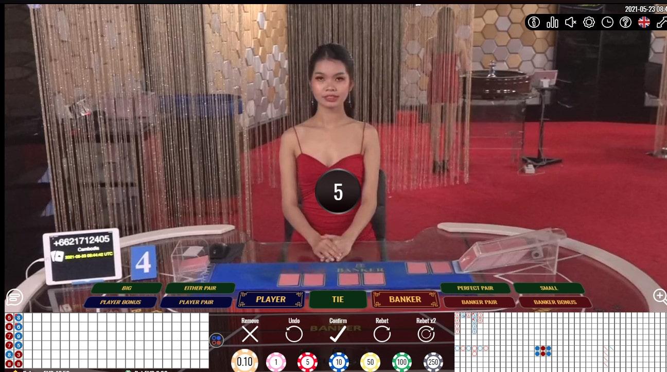 Croupière en live a une table de baccarat de Vivo Gaming